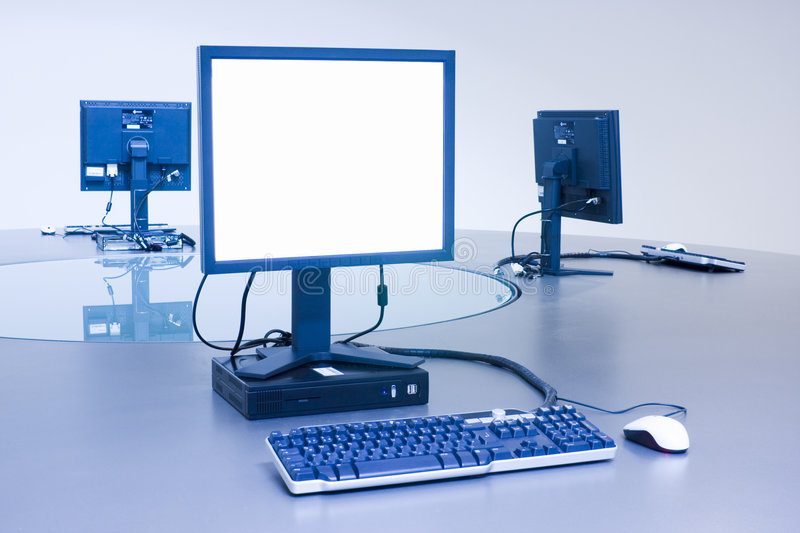Three computers on desktop royalty free stock images