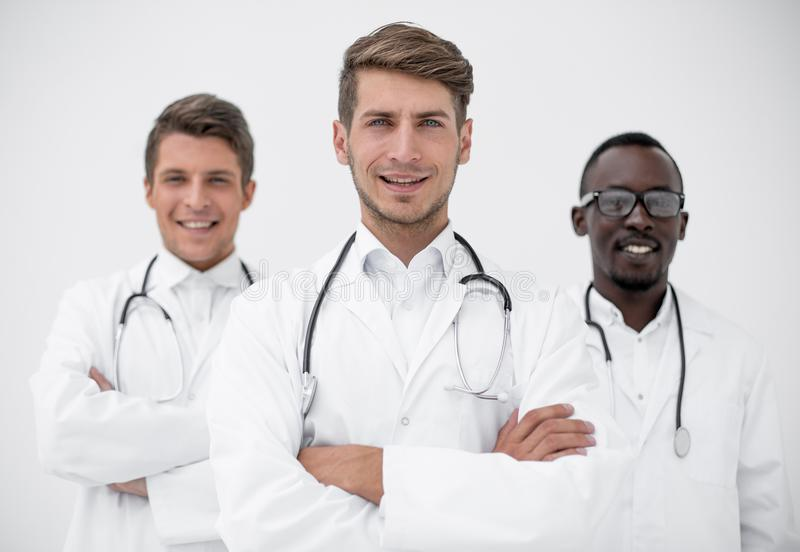 Three confident doctors colleagues standing together stock photography