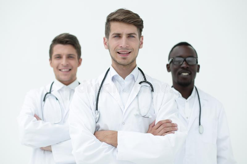 Three confident doctors colleagues standing together stock photo