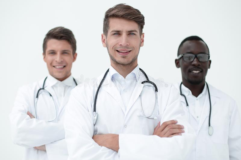 Three confident doctors colleagues standing together royalty free stock images