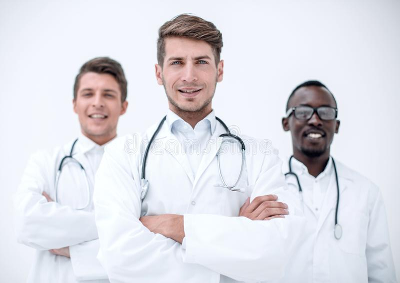 Three confident doctors colleagues standing together stock images