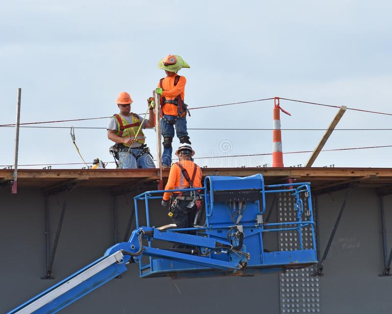 Three construction workers on a new bridge royalty free stock photos