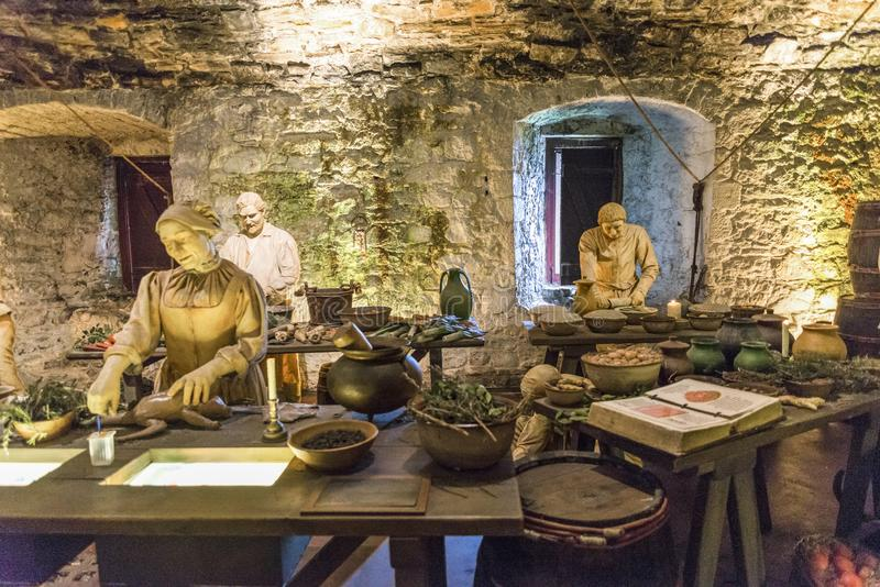 Three cooks prepare ingredients in the Great Kitchen for the next meal, Stirling Castle royalty free stock photos