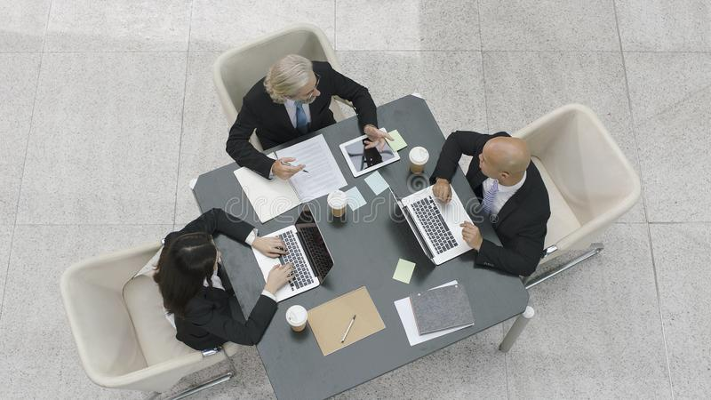 Three corporate executives meeting in office royalty free stock image