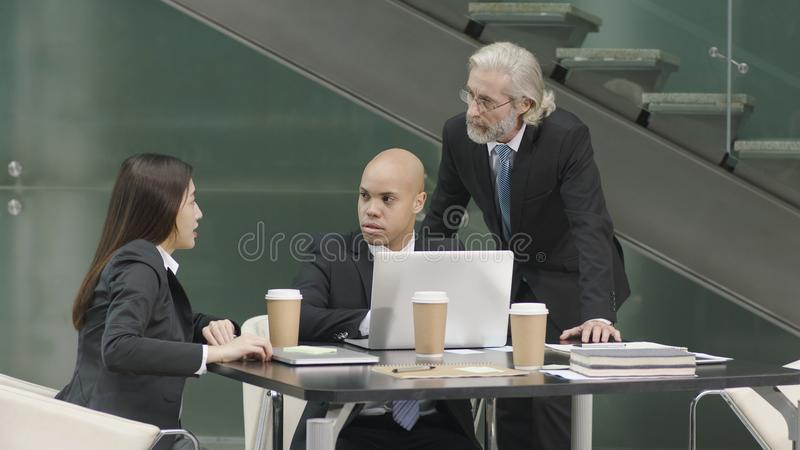Three corporate executives meeting in office royalty free stock images