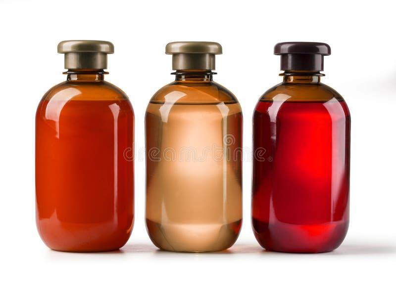 Three cosmetic bottles royalty free stock photos