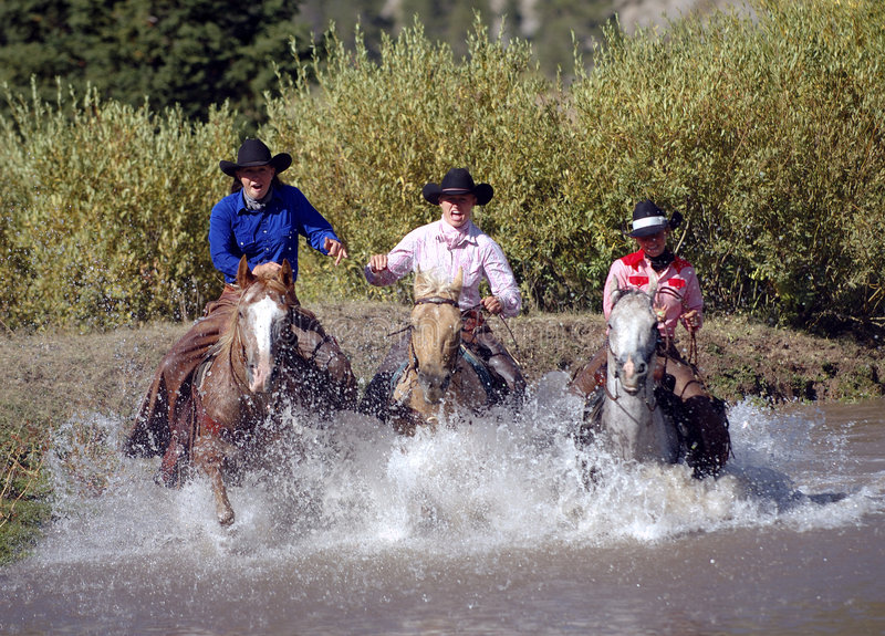 Download Three Cowgirls Crossing Pond Stock Photo - Image: 263336