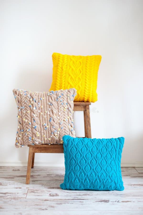 Three crocheted cushions stock image