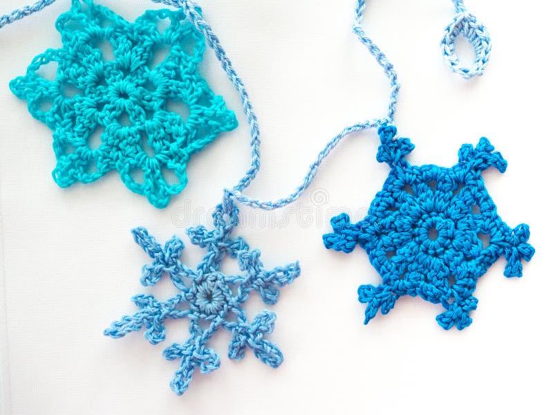 Three Crocheted Snowflakes royalty free stock photo