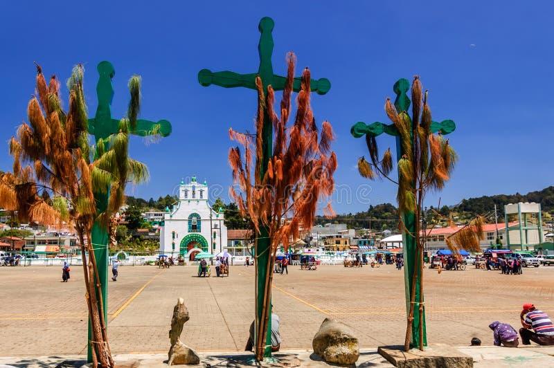 Three crosses, church & plaza, Chamula, Mexico. Chamula, Mexico - March 25, 2015: Town plaza & ornate exterior of Templo de San Juan Bautista in Chamula, an stock photos