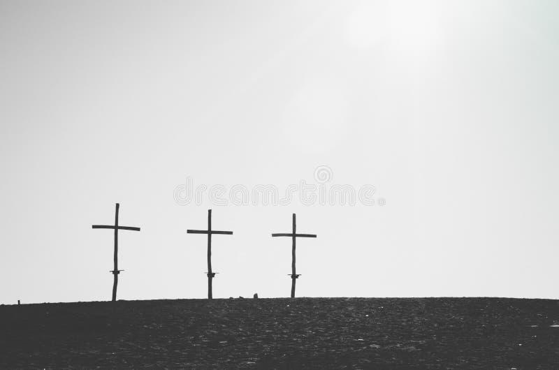 Three crosses on the horizont. Three similar crosses on the horizont line in black and white royalty free stock image