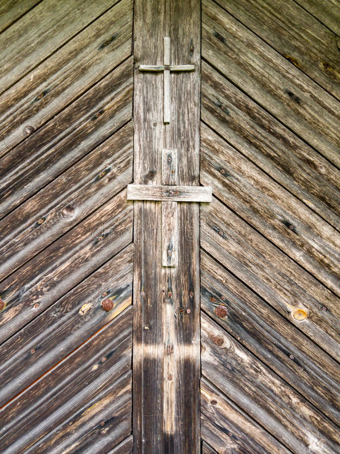 Three crosses. Old wooden crosses on a wooden background. Old wooden crosses on a wooden floor. Two crosses and one cross shadow stock photo