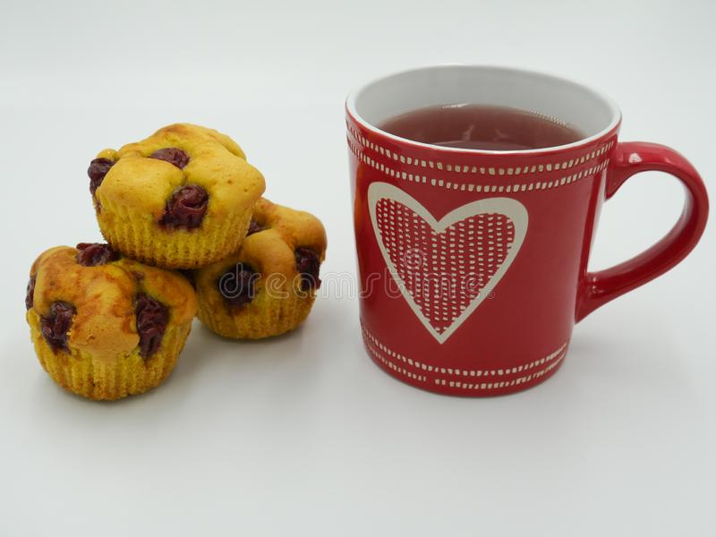 Three cup cakes served with tea tea stock photo