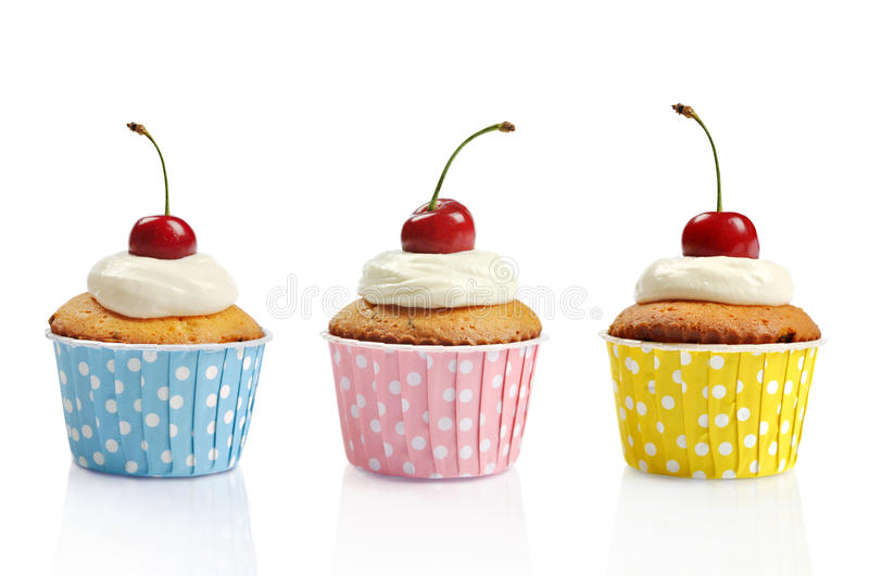 Three Cupcakes And Cherries Royalty Free Stock Images