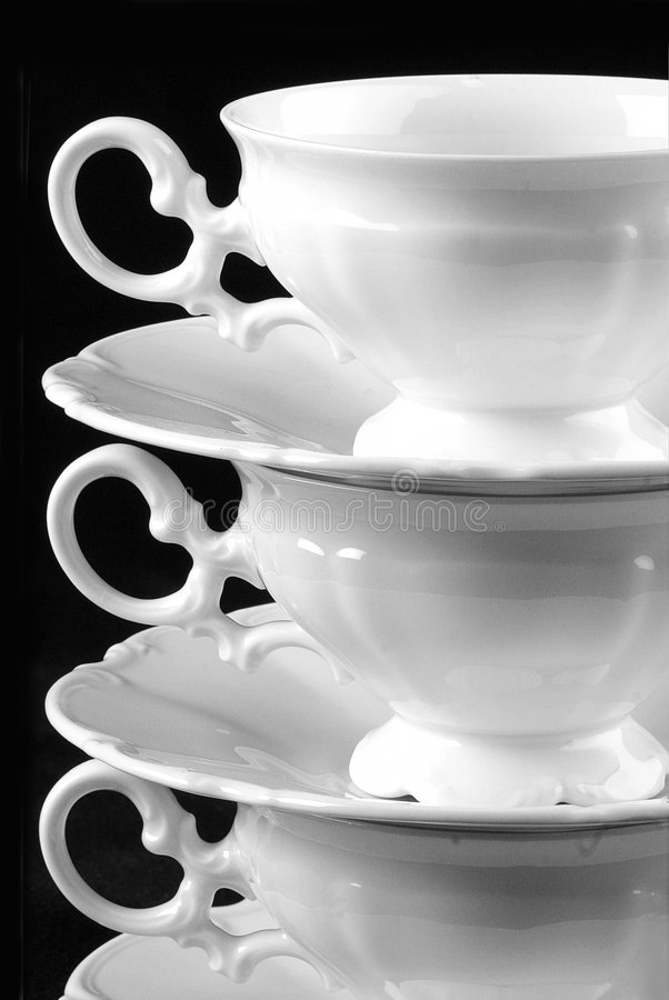Three cups and saucers stock photo