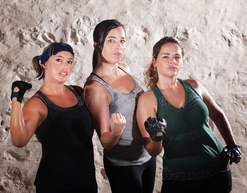 Three Cute Boot Camp Style Athletes stock image