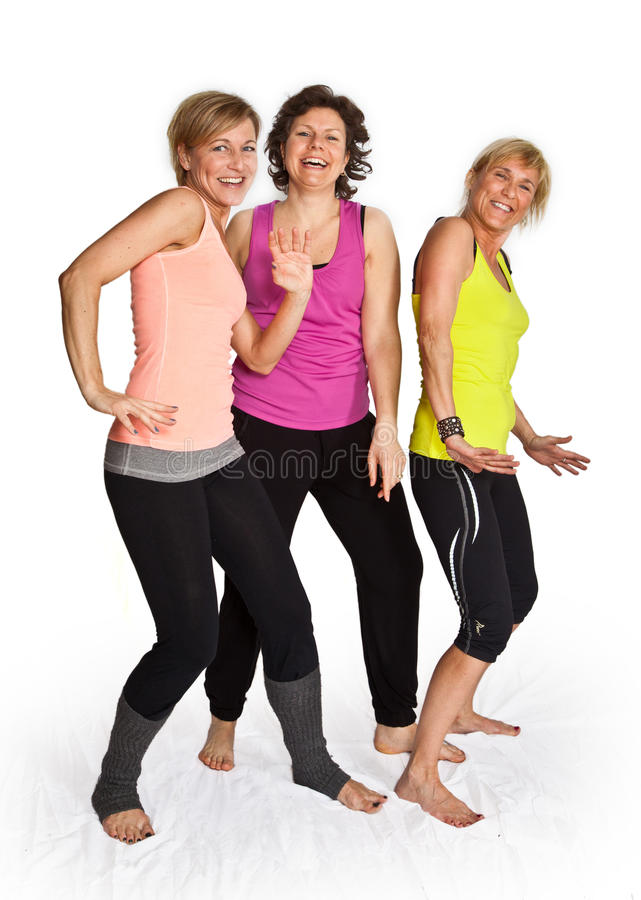 Three cute woman dancing royalty free stock image
