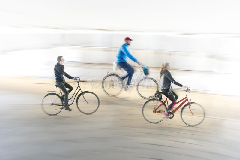 Three cyclists royalty free stock photo