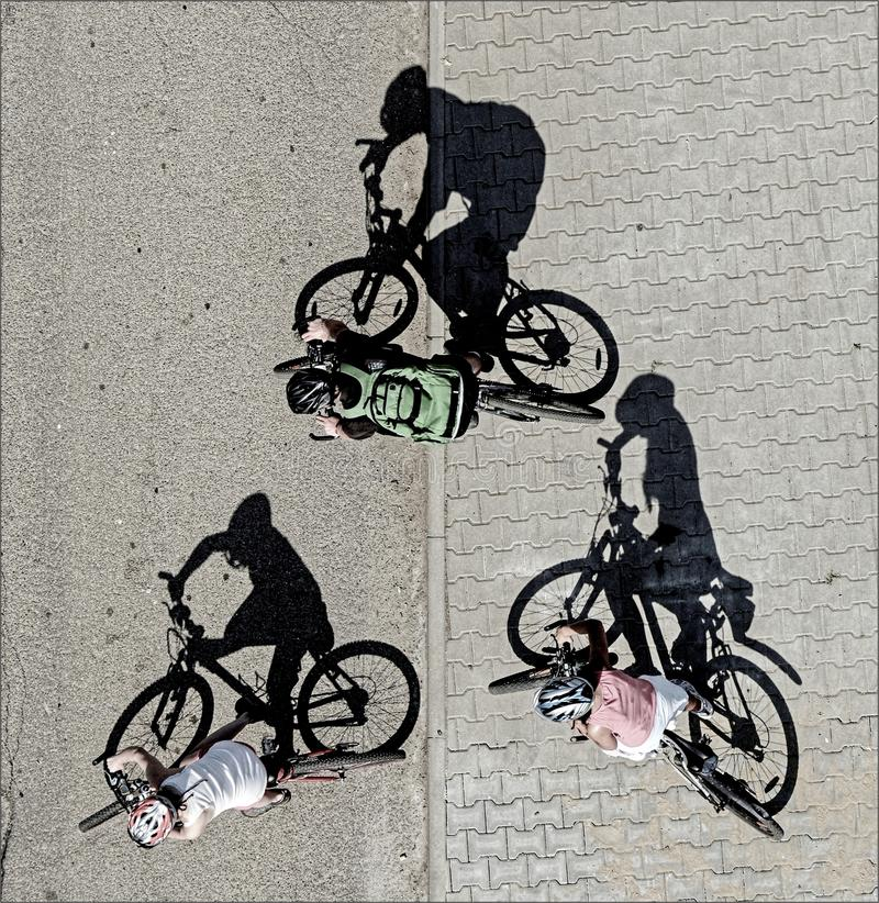 Three cyclists stock images