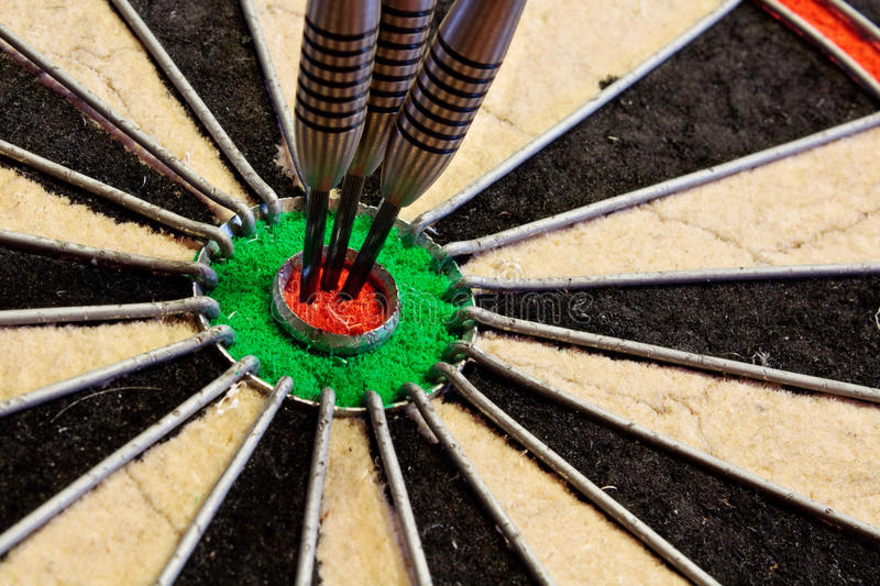 Download Three Darts in bullseye stock photo. Image of bully, dartboard - 26426316