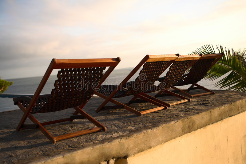 Download Three deck chair chairs stock photo. Image of resort, tide - 3969716