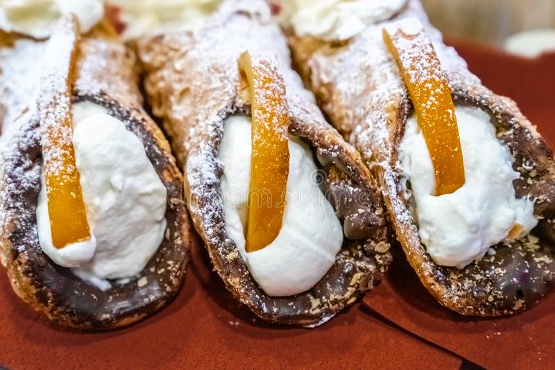 Three delicious sicilian cannoli stuffed with cream cheese stock images