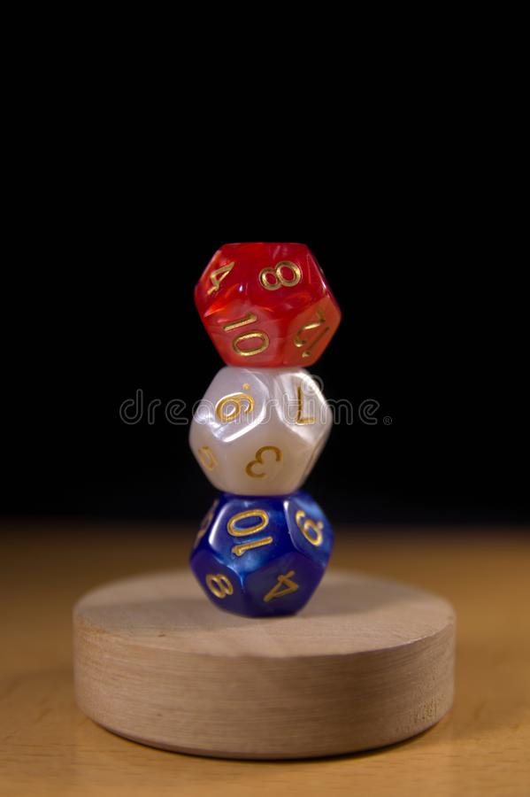 Three dice forming the flag of France. Three dice of red, white and blue colors stacked in a way that mimic the French flag royalty free stock image