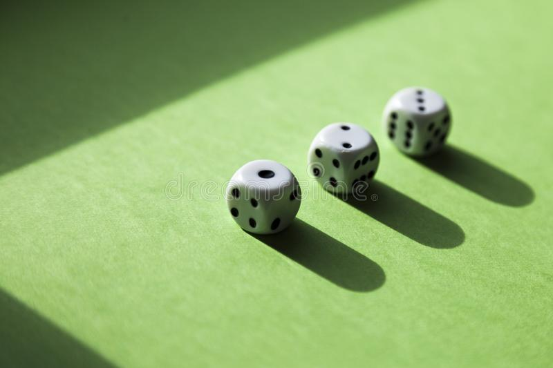 Three dice in a row with the numbers stock photo