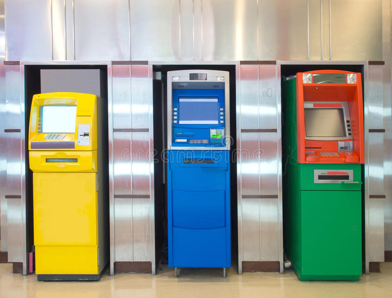 Three different automatic teller machine against aluminum wall stock photography