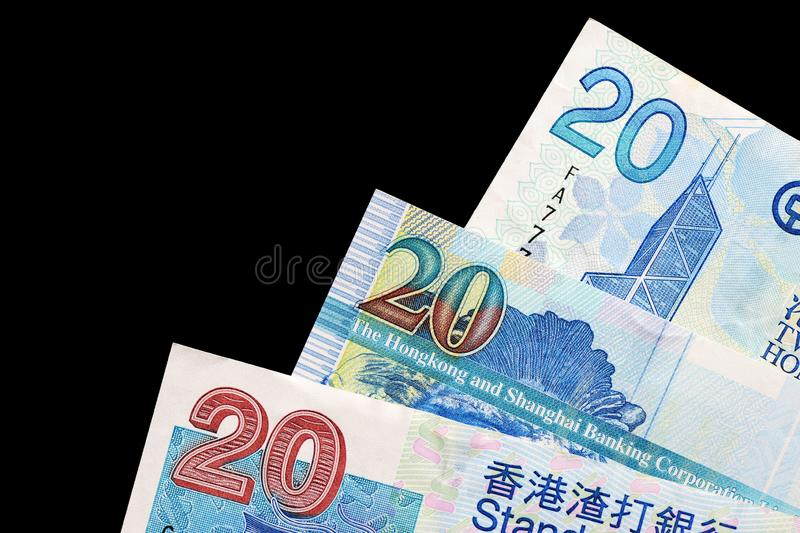 Three different bills in twenty Hong Kong dollars on a dark background stock photography