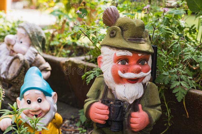 Three different garden gnomes representing different moments. In switzerland stock photo