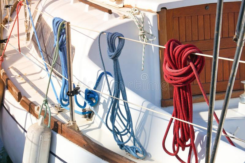 Nautical scots. Three different nautical scots hanging on the deck of sailing yacht stock images