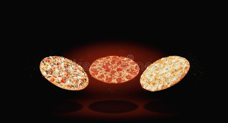 Three different pizza fly in the air against a dark background. menu and selection concept stock photo
