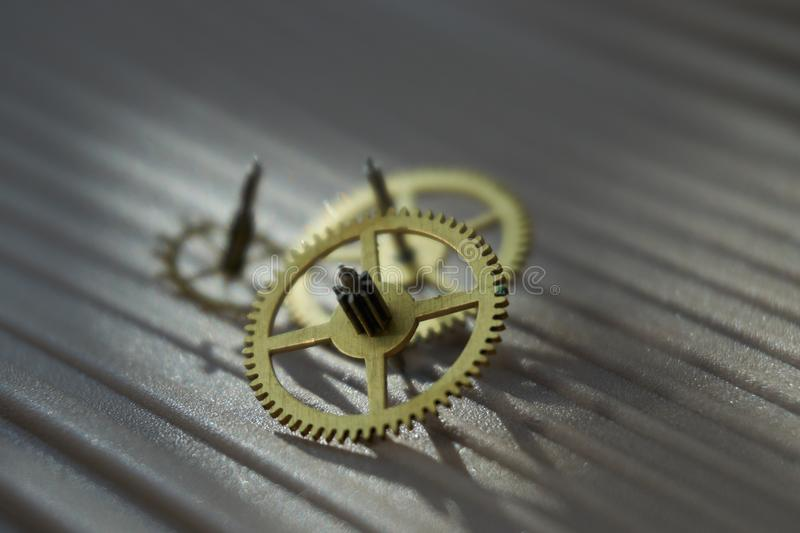 Three different toothed brass metal cog wheels stock photography