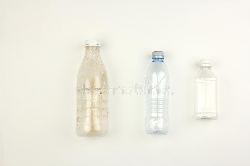 Three different empty used plastic bottles, garbage on white background, pollution environmental problem stock photo