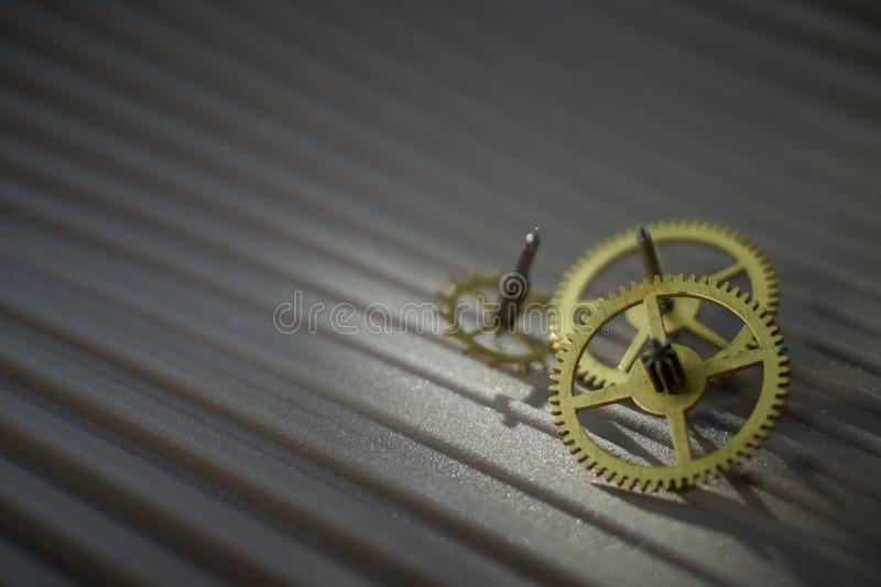 Three different toothed brass metal cog wheels royalty free stock image