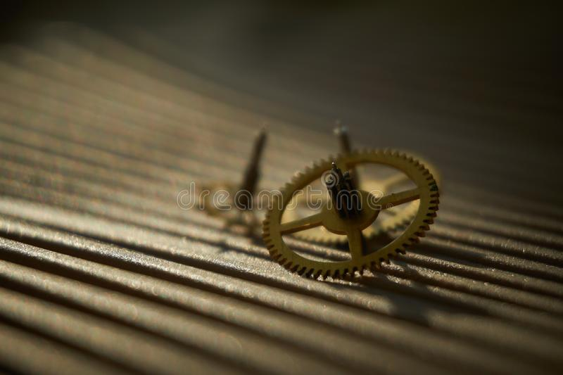 Three different toothed brass metal cog wheels royalty free stock photos