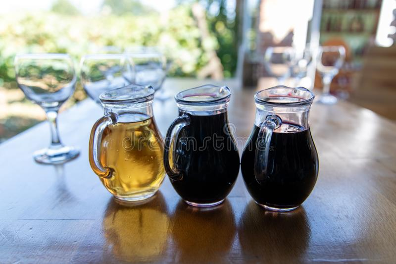 Three different wines in jugs. Tbilisi, Georgia royalty free stock images