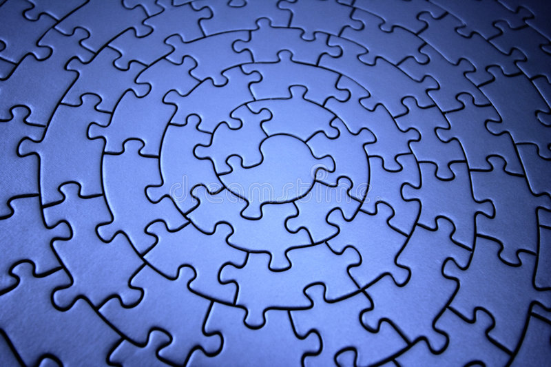 Three-dimensional blue jigsaw. Wide angle, shallow DOF, focus is on the piece in the center - adobe RGB stock images