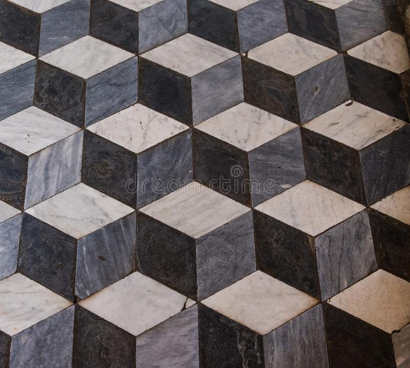 The three-dimensional effect f a marble cube floor in a church. This is a optical illusion of solid costruction royalty free stock photos
