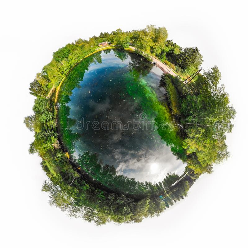 A three dimensional panoramic view of the turquoise spring Kiikunlahde in Hollola, Finland in a mini planet panorama style.  stock photo