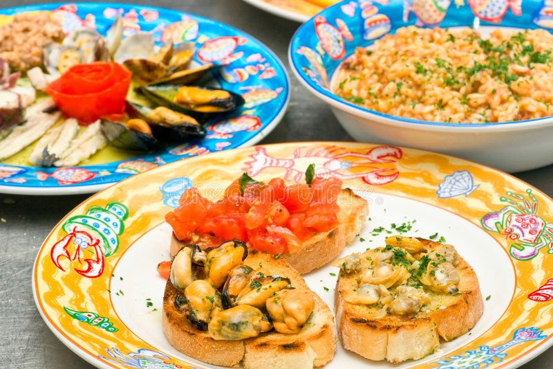 Three dish of seafood, Mix Bruschetta, Rice with s royalty free stock images