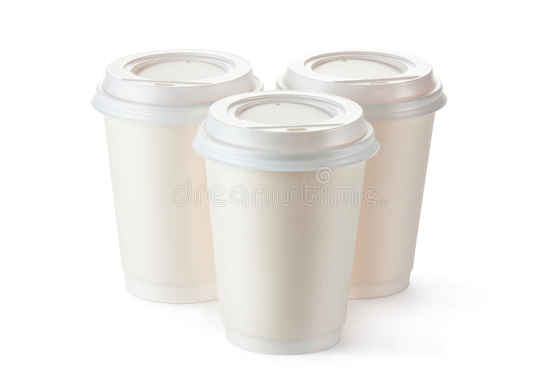 Three disposable coffee cups with plastic lid royalty free stock photography