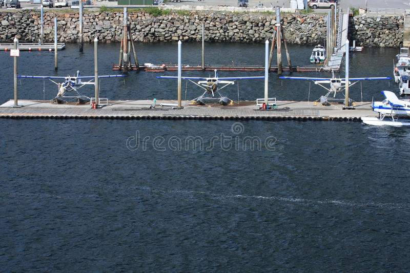 Three docked float planes in Ketchikan, Alaska stock photos