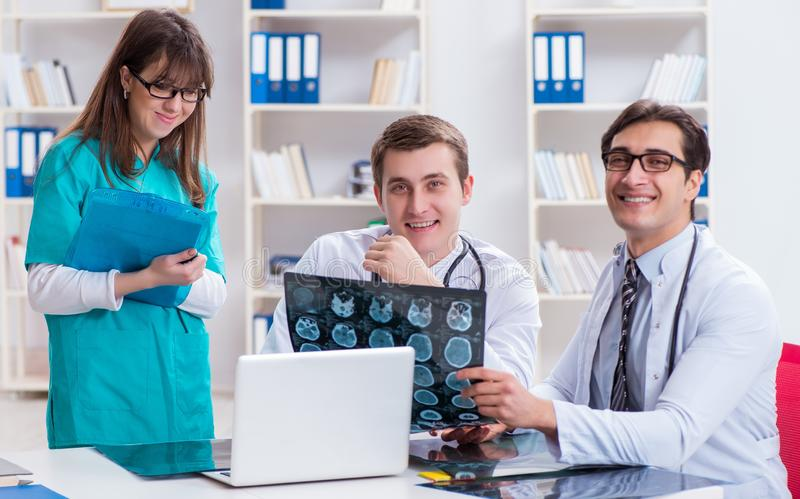 The three doctors discussing scan results of x-ray image stock photos