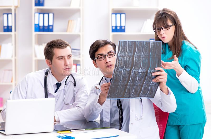 The three doctors discussing scan results of x-ray image royalty free stock photos