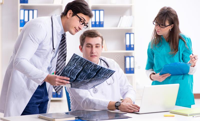 The three doctors discussing scan results of x-ray image royalty free stock photography