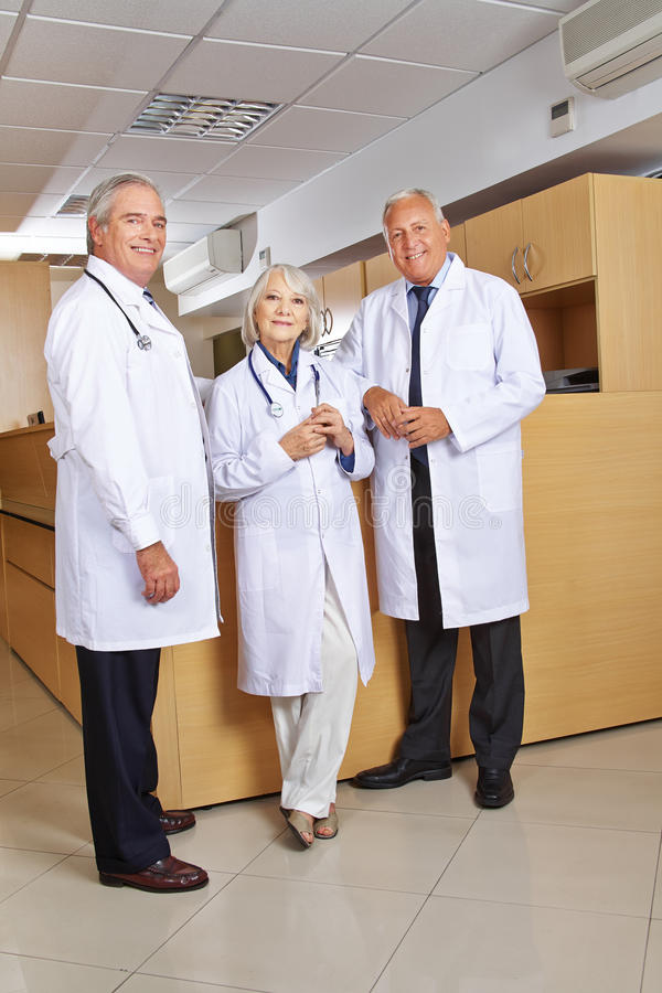 Three doctors standing in hospital stock images