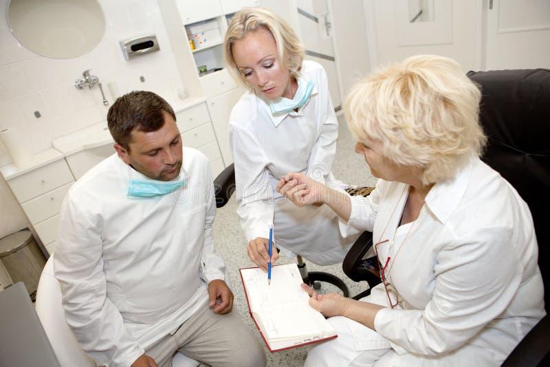 Three Doctors Talking Stock Photos