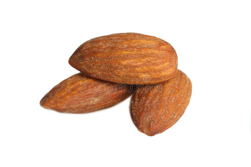 Three dried almond nuts royalty free stock photo
